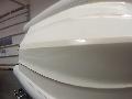Aplikace ochranné folie PVC 180 mikronů na laminátové dno gumového člunu + druhá vrstva na ochranu kýlu proti poškození